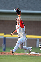 Lowell Spinners first baseman Sam Travis (40) stretches for a throw during a game against the Batavia Muckdogs on July 16, 2014 at Dwyer Stadium in Batavia, New York.  Lowell defeated Batavia 6-4.  (Mike Janes/Four Seam Images)