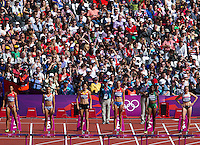 03 AUG 2012 - LONDON, GBR - Competitors wait for the start of their 100m hurdle heat in the women's heptathlon at the London 2012 Olympic Games athletics in the Olympic Stadium in the Olympic Park in Stratford, London, Great Britain. Pictured from the left are Hyleas Fountain (USA) of the USA, Jessica Ennis (GBR) of Great Britain, Sara Aerts (BEL) of Belgium, Tatyana Chernova (RUS) of Russia, Uhunoma Osazuwa (NGR) of Nigeria and Brianne Theisen (CAN) of Canada (PHOTO (C) 2012 NIGEL FARROW)