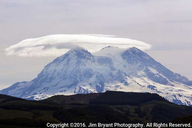 Mt. Rainier with lenticular clouds. The 14,411 foot volcano which covers 228,480 acres was designated a National Park in 1899. Washington.  Jim Bryant Photo. ©2016. All Rights Reserved.