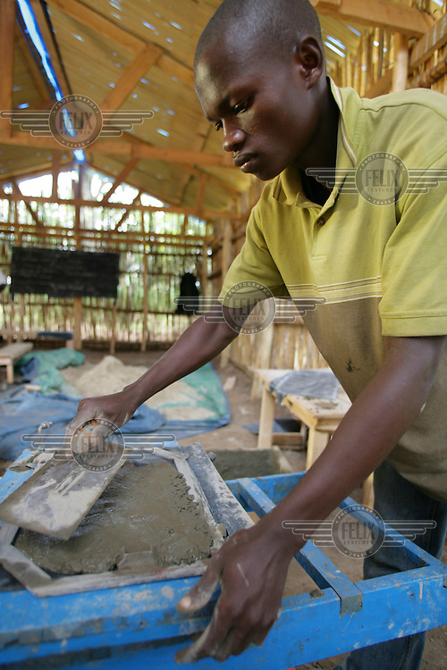 A former child soldier receiving skills training at a UNICEF funded rehabilitation centre.