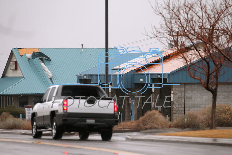 Dozens of homes and businesses with roof, fence and tree damage are seen in the Ranchos area of  Gardnerville, Nev., on Friday, Feb. 6, 2015. A powerful wind and rain storm will continue to move through the area over the next few days. <br /> Photo by Cathleen Allison