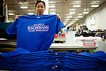 Hong Nguyen folds campaign t-shirts printed for Republican presidential candidate Rep. Michele Bachmann at Competitive Edge, Inc. in Clive, Iowa, August 10, 2011.