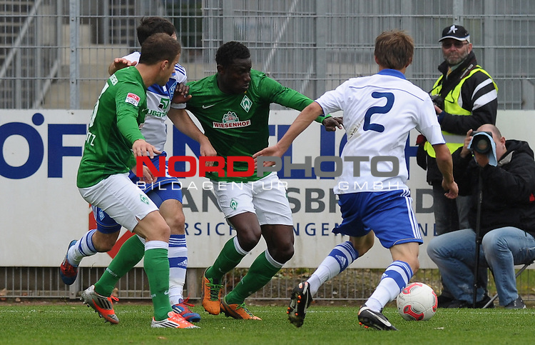 13.10.2012, TimePartner Arena, Cloppenburg, GER, 1.FBL, FSP, Werder Bremen vs Dynamo Kiew, im Bild Lukas Schmitz (Bremen #13), Joseph Akpala (Bremen #19), Danilo Silva (Kiew #2)<br /> <br /> // during the friendly match Werder Bremen vs Dynamo Kiew on 2012/10/13, TimePartner Arena, Cloppenburg, Germany.<br /> Foto &copy; nph / Frisch *** Local Caption ***
