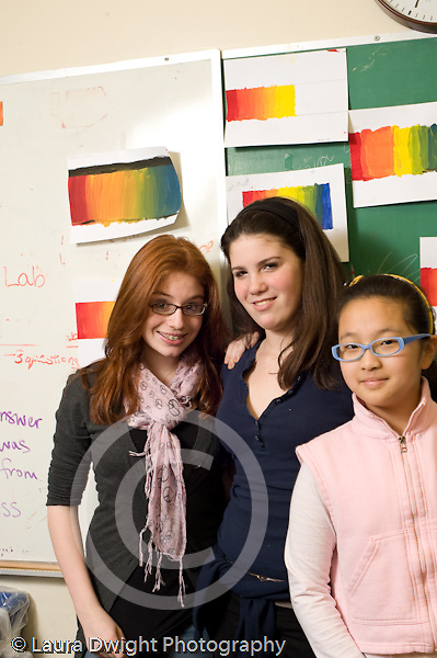 Public Middle School Grade 6 three female students posing height difference one student wearing glasses vertical