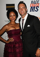 CENTURY CITY, CA, USA - MAY 02: Tamera Mowry, Adam Housley at the 21st Annual Race To Erase MS Gala held at the Hyatt Regency Century Plaza on May 2, 2014 in Century City, California, United States. (Photo by Celebrity Monitor)