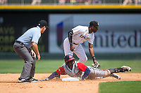 Charlotte Knights shortstop Tim Anderson (7) waits for the throw as Adonis Garcia (30) of the Gwinnett Braves slides head first into second base while umpire Derek Mollica looks on at BB&T BallPark on May 22, 2016 in Charlotte, North Carolina.  The Knights defeated the Braves 9-8 in 11 innings.  (Brian Westerholt/Four Seam Images)