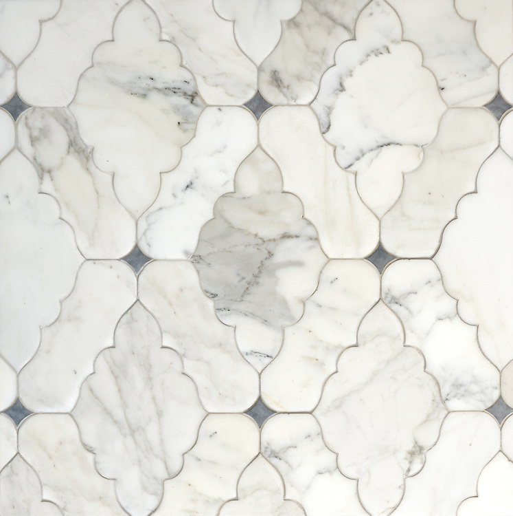 Ganesha, a waterjet stone, mosaic shown in Calacatta Tia and Bardiglio with a venetian finish, is part of the Silk Road Collection by New Ravenna.