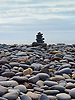 A cairn is a man-made pile (or stack) of stones. The word cairn comes from the Scottish Gaelic: c&agrave;rn. <br />