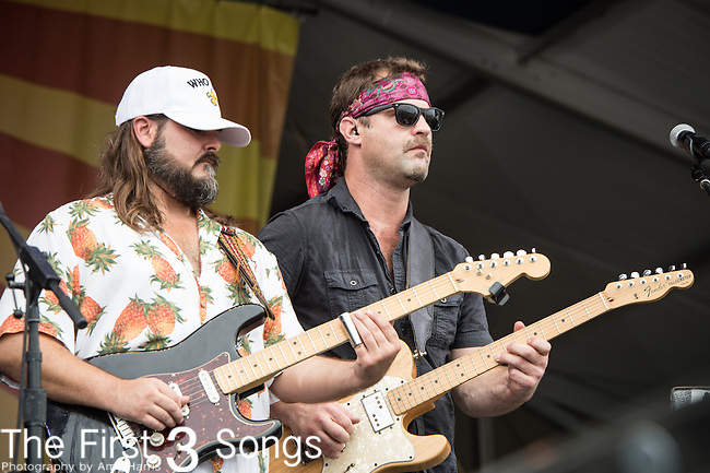 Chris Mule and Aaron Wilkinson of the Honey Island Swamp Band perform during the 2015 New Orleans Jazz & Heritage Festival in New Orleans, Louisiana.