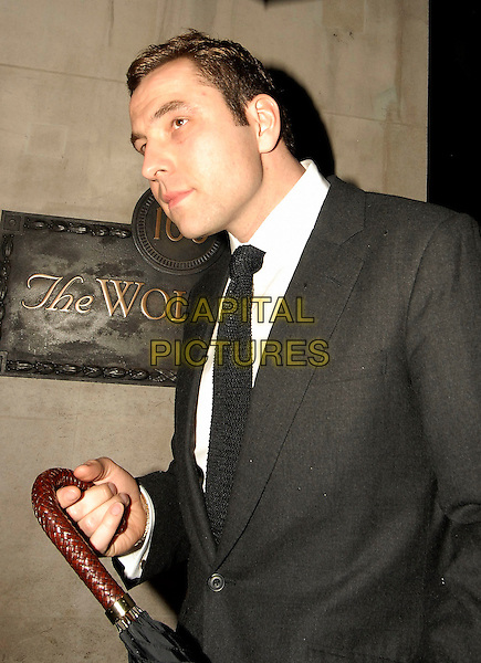 DAVID WALLIAMS.Leaving The Wolseley, London, England, April 9th 2006..half length umbrella raining black suit tie.Ref: SW.www.capitalpictures.com.sales@capitalpictures.com.©Stephen Walters/Capital Pictures.