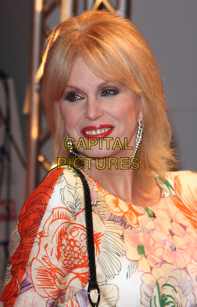 JOANNA LUMLEY.The 15th National Television Awards held at the O2 Arena, London, England. .January 20th, 2010 .NTA NTAs headshot portrait red lipstick white orange pink green floral print dangling earrings silver .CAP/ROS.©Steve Ross/Capital Pictures.