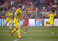 Chicago midfielder Marco Pappa (16) shots and scores an early goal before Columbus defender Sebastian Miranda (21) can make the block.  The Chicago Fire defeated the Columbus Crew 2-1 at Toyota Park in Bridgeview, IL on June 23, 2012.
