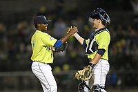 Pitcher Ezequiel Zabaleta (4) of the Columbia Fireflies greets catcher Hayden Senger after earning the save in a game against the Charleston RiverDogs on Saturday, April 6, 2019, at Segra Park in Columbia, South Carolina. Columbia won, 3-2. (Tom Priddy/Four Seam Images)