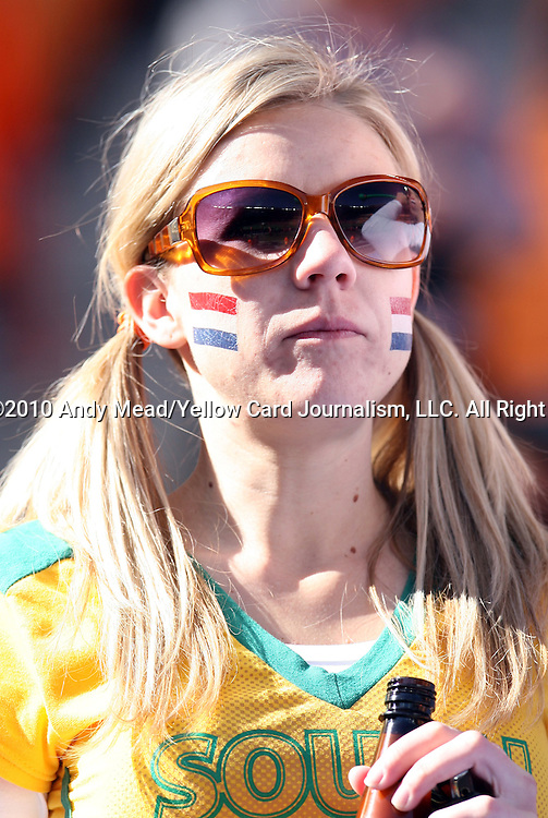 14 JUN 2010:  Dutch fan in the stands sporting a South Africa top.  The Netherlands National Team played the Denmark National Team at Soccer City Stadium in Johannesburg, South Africa in a 2010 FIFA World Cup Group E match.