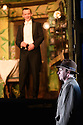 London, UK. 04.11.2016. AN INSPECTOR CALLS, by J B Priestley, opens at the Playhouse Theatre.  It is the 70th anniversary of the first UK staging of the play and the 25th anniversary of its first appearance at The National Theatre, directed by Stephen Daldry. Lighting design is again by Rick Fisher with set and costume design by Ian MacNeil. Picture shows: Hamish Riddle (Eric Birling), Liam Brennan (Inspector Goole). Photograph © Jane Hobson.