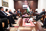 Palestinian President Mahmoud Abbas (Abu Mazen) meets with the Palestinian chief of Election Commissioner, Hanna Nasser, in the West Bank city of Ramallah, on June 12, 2017. Photo by Osama Falah