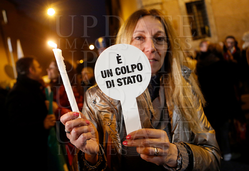 "Militanti di Forza Italia al comizio dell'ex Presidente del Consiglio Silvio Berlusconi sotto la sua residenza di Palazzo Grazioli, contro la sua decadenza dalla carica di senatore, a Roma, 27 novembre 2013.<br /> Forza Italia (Go Italy) party's activists attend a protest with Italian former Premier Silvio Berlusconi outside of his residence, against his expulsion from the Senate, following his conviction for tax fraud, in Rome, 27 November 2013. The sign reads ""It's a coup"".<br /> UPDATE IMAGES PRESS/Riccardo De Luca"