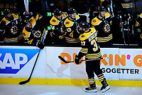 April 25, 2018: Boston Bruins center Patrice Bergeron (37) celebrates a goal with his bench during game seven of the first round of the National Hockey League's Eastern Conference Stanley Cup playoffs between the Toronto Maple Leafs and the Boston Bruins held at TD Garden, in Boston, Mass. Boston defeats Toronto 7-4 and wins the best of seven series 4 games to 3 to advance to round two.