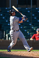Glendale Desert Dogs catcher Kyle Farmer (7) at bat during an Arizona Fall League game against the Surprise Saguaros on October 23, 2015 at Salt River Fields at Talking Stick in Scottsdale, Arizona.  Glendale defeated Surprise 9-6.  (Mike Janes/Four Seam Images)