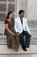 Agra, India.  Taj Mahal.  Indian Couple.  Both wear a bindi on their foreheads, the symbol signifying the third eye, the Hindu's search for inner enlightenment.