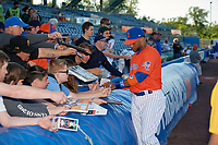 Syracuse Mets Robinson Cano (4) signs autographs before an International League game against the Charlotte Knights on June 11, 2019 at NBT Bank Stadium in Syracuse, New York.  Syracuse defeated Charlotte 15-8.  (Mike Janes/Four Seam Images)