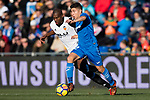 Geoffrey Kondogbia of Valencia CF in action against Francisco Portillo Soler of Getafe CF during the La Liga 2017-18 match between Getafe CF and Valencia CF at Coliseum Alfonso Perez on December 3 2017 in Getafe, Spain. Photo by Diego Gonzalez / Power Sport Images