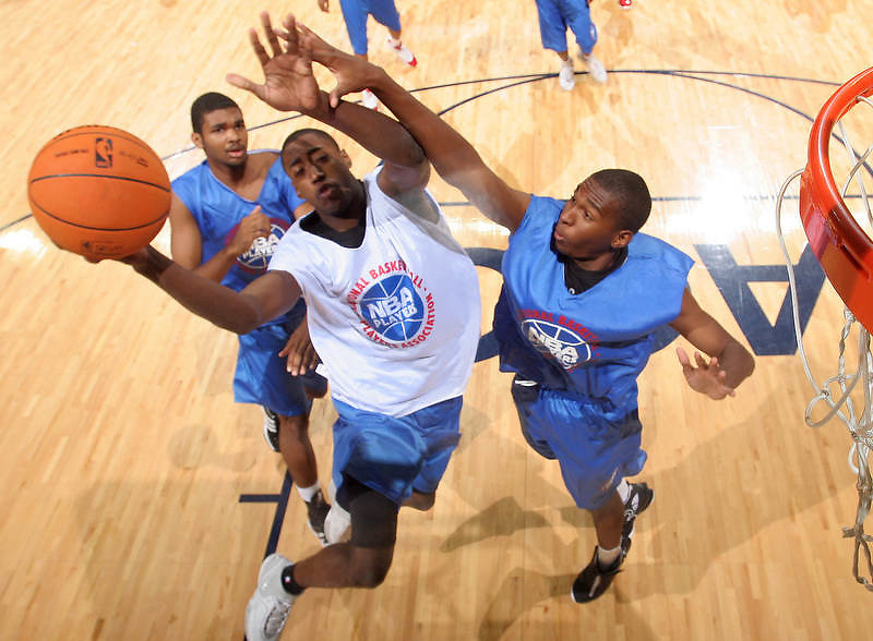 is defended by 2G Elston Turner (Roseville, CA / Roseville) during the NBA Top 100 Camp held Friday June 22, 2007 at the John Paul Jones arena in Charlottesville, Va. (Photo/Andrew Shurtleff)
