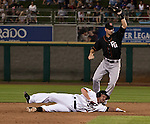 Reno Aces Mike DeMark is forced out as Fresno Grizzlies second baseman Brock Bond takes the throw during their game on Friday night August 10, 2012 at Aces Ballpark in Reno NV.