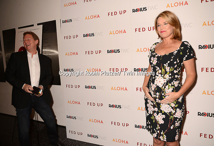 "Savannah Guthrie and husband Mike Feldman attendthe New York Premiere of ""FED UP"" on May 6, 2014 at The Museum of Modern Art in New York City."
