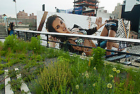 A billboard for Armani Exchange is seen from the new High Line Park in the New York neighborhood of Chelsea on Monday, June 8, 2009. The park, utilizing the railbed of the former High Line which ceased operation in 1980, has finished the first phase of its transformation into a 1.5 mile park running north from the trendy Meatpacking District. The original High Line, opened in 1934, traveled from West 35th, connecting with the railyards, down to Houston Street, traveling through the center of buildings where goods could be loaded and unloaded. The park officially opens to the public on June 9, 2009.  (© Richard B. Levine)