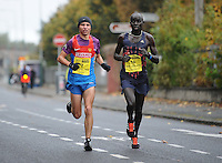 26/10/2015; 2015 SSE Airtricity Dublin Marathon, St Laurence's Road, Dublin. <br /> Ruslan Khoroshilov of Russia with Lazarus Kimutai of Kenya.<br /> Picture credit: Tommy Grealy/actionshots.ie.