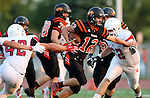 SIOUX FALLS, SD - AUGUST  28: Jack Schelhaas #12 from Washington looks for room between Andrew Sorensen #42 and Sam Loney #62 from Brandon Valley in the first half of their game Friday night at Howard Wood Field. (Photo by Dave Eggen/Inertia)
