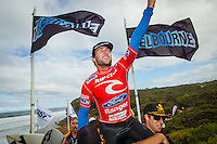 BELLS BEACH, Victoria/Australia (Sunday, April 24, 2011) -Wes Berg (AUS) Joel Parkinson's trainer helps carry Parkinson off the beach after his win. The final day of the Rip Curl Pro Bells Beach presented by Ford Ranger, the second stop on the 2011 ASP World Title season, has been called on this morning with Round 5 commencing at 7am...in clean 6'-8' surf Joel Parkinson (AUS) took out his third Bells Beach Title defeating good friend Mick Fanning (AUS) in an action packed final. Parkinson finished the event with a perfect 10 point ride. .. - Photo: joliphotos.com