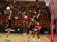 27.10.2013 Silver Fern Maria Tutaia and Malawi's Caroline Mtukule in action during the Silver Ferns V Malawi New World Netball Series played at the Pettigrew Green Arena in Napier. Mandatory Photo Credit ©Michael Bradley.