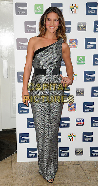 AMANDA BYRAM.At the Carphone Warehouse Appys Awards, Vinopolis, Stoney Street, London, England, UK, April 11th 2011..full length long maxi one shoulder dress  grey gray print  hand on hip .CAP/CAN.©Can Nguyen/Capital Pictures.