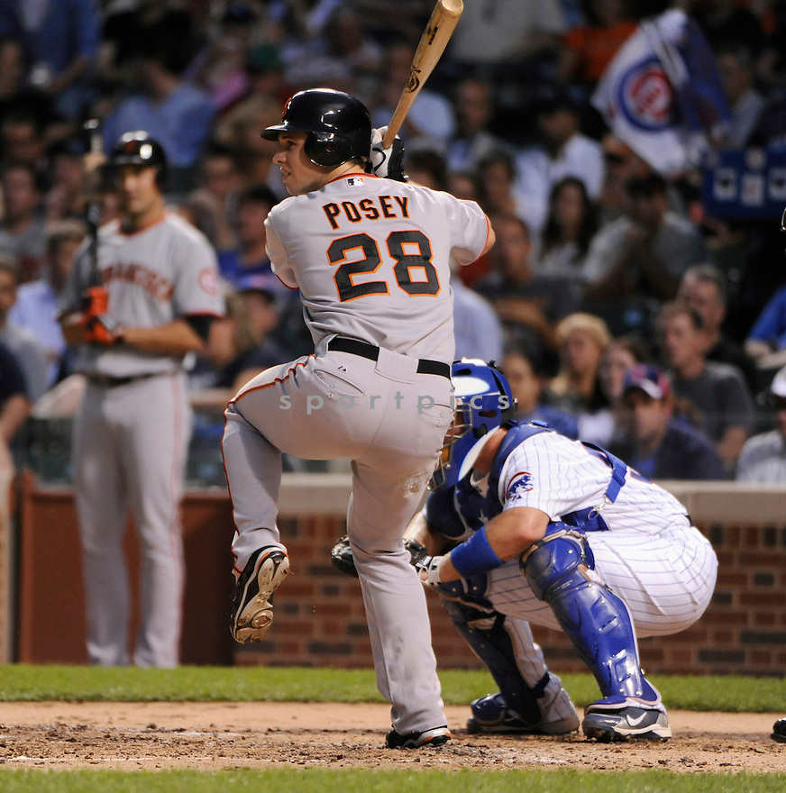 BUSTER POSEY, of the San Francisco Giants, in action during the Giants game against the Chicago Cubs on September 23, 2010 at Wrigley Field in Chicago, IL...San Francisco Giants beat the Chicago Cubs 13-0..