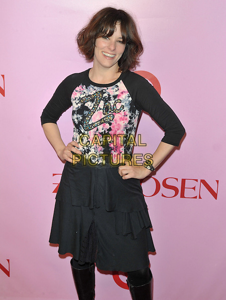 PARKER POSEY.Zac Posen For Target Collection Launch held at the New Yorker Hotel, New York, NY, USA, 15th April 2010..half length black slogan logo print top skirt smiling hands on hips tiered .CAP/ADM/BM.©Bill Menzel/AdMedia/Capital Pictures.
