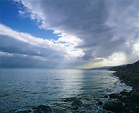 Looking south along the Israel shore of the Dead Sea near Mezada under a stormy sky; Israe