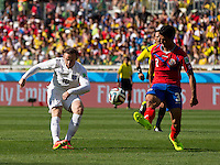 Wayne Rooney of England tries a chipped goal shot