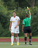 Yellow Card: Western New York Flash forward Abby Wambach (20) from Christina Unkel. In a National Women's Soccer League (NWSL) match, Boston Breakers (blue) tied Western New York Flash (white), 2-2, at Dilboy Stadium on August 3, 2013.