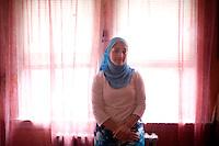 "Shayreen, 16, poses for a portrait in her beedroom in her home in West Warwick, Rhode Island, USA, on Sunday, Aug. 22, 2011.  Unlike the rest of her family, Shayreen is very devoted to her Muslim faith.  ""I feel it's my responsibility as a Muslim to be a positive role model,"" said Shayreen, ""I see a negative energy toward Muslims in the media.""  Shayreen is will be a high school junior at Lincoln School, an all-girls Quaker school in Rhode Island. The rest of her family is not particularly religious.  When Shayreen began wearing the hijab head covering in her early teens, ""My parents were very supportive, but my aunt tried to talk me out of it. My grandmother was upset.  I was more worried about what my family would think [than what other people would think].""..photo by: M. Scott Brauer for Education Week"
