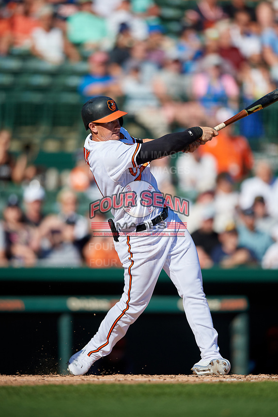 Baltimore Orioles left fielder Austin Hays (21) hits a home run during a Grapefruit League Spring Training game against the Detroit Tigers on March 3, 2019 at Ed Smith Stadium in Sarasota, Florida.  Baltimore defeated Detroit 7-5.  (Mike Janes/Four Seam Images)