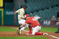 Joe Davis (44) of the Houston Cougars attempts to tag out Pat DeMarco (18) of the Vanderbilt Commodores during game nine of the 2018 Shriners Hospitals for Children College Classic at Minute Maid Park on March 3, 2018 in Houston, Texas. The Commodores defeated the Cougars 9-4. (Brian Westerholt/Four Seam Images)