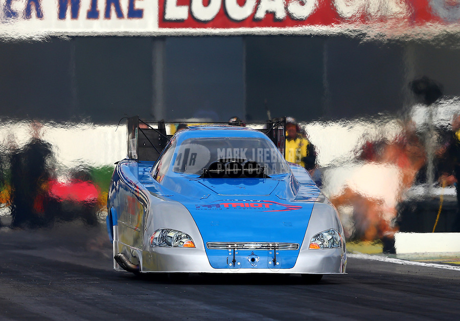 Feb 7, 2014; Pomona, CA, USA; NHRA funny car driver Terry Haddock during qualifying for the Winternationals at Auto Club Raceway at Pomona. Mandatory Credit: Mark J. Rebilas-