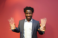 Wednesday 08 May 2014<br /> Pictured: Wilfried Bony with two of the four awards he won.<br /> Re: Wilfried Bony stole the show at Swansea City's annual awards dinner on Wednesday night. <br /> The club-record signing picked up four of the main awards on offer at the official Player of the Season function, run in conjunction with the Supporters Trust and Executive Fundraising Committee. <br /> Bony was crowned Supporters' Player of the Year following a season in which he lived up to expectations since his £12million move from Dutch side Vitesse Arnhem last July. <br /> The 25-year-old, who is set to represent the Ivory Coast at the World Cup this summer, was also named Players Player of the Year along with Best Newcomer of the Year. <br /> And his 24 goals – 15 in the league – meant he landed the Top Goalscorer accolade to top off a hugely successful season at the Liberty.