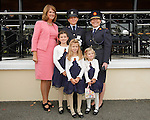 10/09/2015<br /> Gary Sheehan Medal Winner Emelia Gilroy, Kildare pictured with her daughters Ella 9, Maya 6 and Lucy 3, An Tanaiste Joan Burton TD and Garda Commissioner Noirin O'Sullivan at the Garda Graduation Ceremony at the Garda College, Templemore, Co. Tipperary.<br /> Pic: Press 22