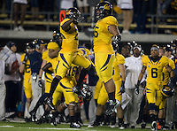 Josh Hill of California gives celebrates with Viliami Moala in the air during the game against Washington at Memorial Stadium in Berkeley, California on November 2nd, 2012.  Washington Huskies defeated California, 13-21.
