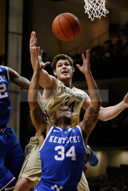 Vanderbilt forward Shelby Moats and UK guard Julius Mays jump to grab a rebound ball during the first half of the UK vs. Vanderbilt men's basketball game at Memorial Gymnasium in Nashville, Tn., on Thursday, January 10, 2013. UK won 60-58. Photo by Tessa Lighty | Staff