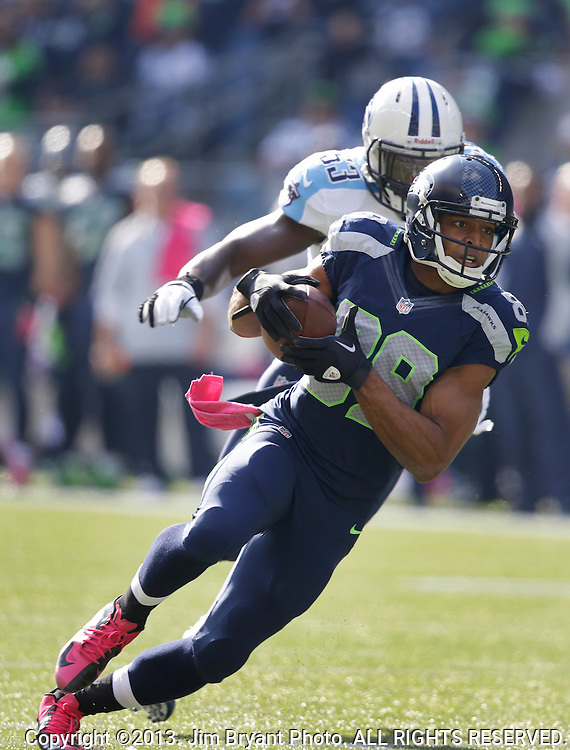 Seattle Seahawks wide receiver Doug Baldwin (89) heads upfield after catching a pass from quarterback Russell Wilson while being guarded by Tennessee Titans  linebacker Moise Fokou (53) in the third quarter at CenturyLink Field in Seattle, Washington on  October13, 2013.  The Seahawks beat the Titians 20-13.   ©2013. Jim Bryant Photo. All Rights Reserved.