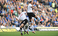 07.11.10 - Cardiff City v Swansea City - Npower Championship -<br /> Alan Tate and Ashley Williams of Swansea City compete with Michael Chopra of Cardiff City.<br /> ©Huw Evans Picture Agency